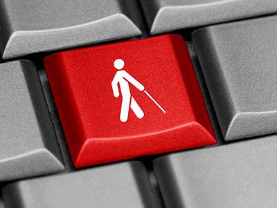 Een toets met een blinden icoontje op een toetsenbord